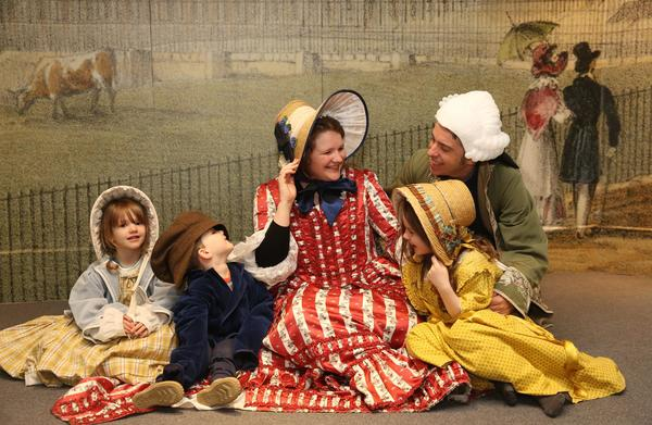 Image: A family dressing up at the Fashion Museum