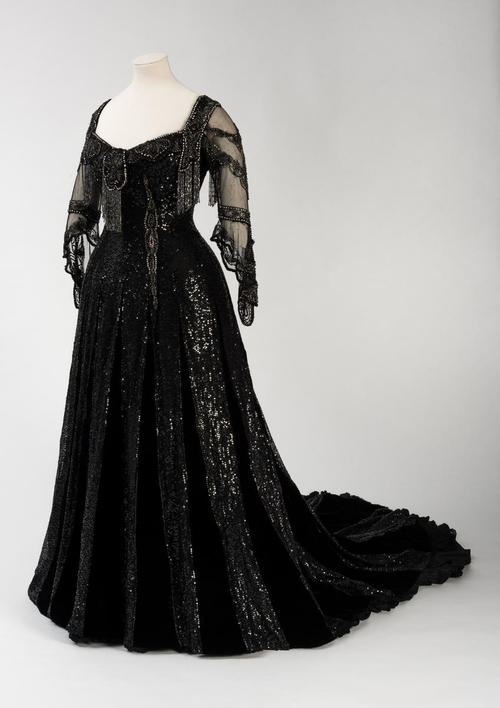 Image: Black silk and velvet embellished evening dress with hand-tamboured sequins, diamantés and bugle beads by Barolet 1908-1910, worn by Queen Alexandra