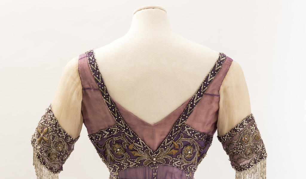 Image: Queen Alexandra's mauve silk chiffon embroidered dress, about 1911