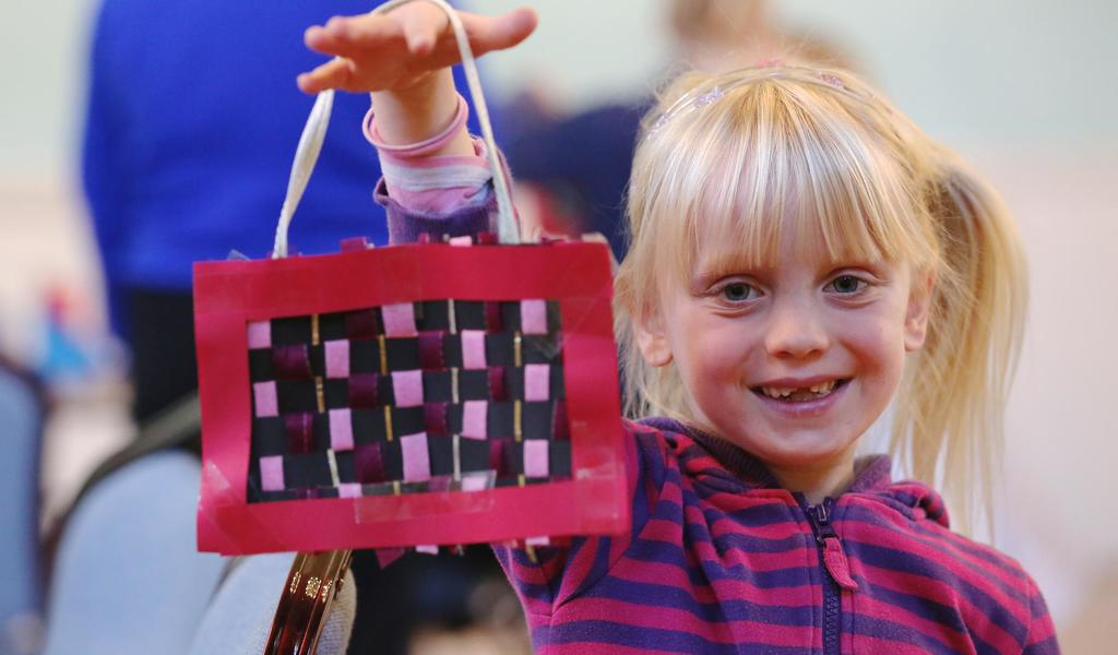 Image: Child taking part in a craft activity