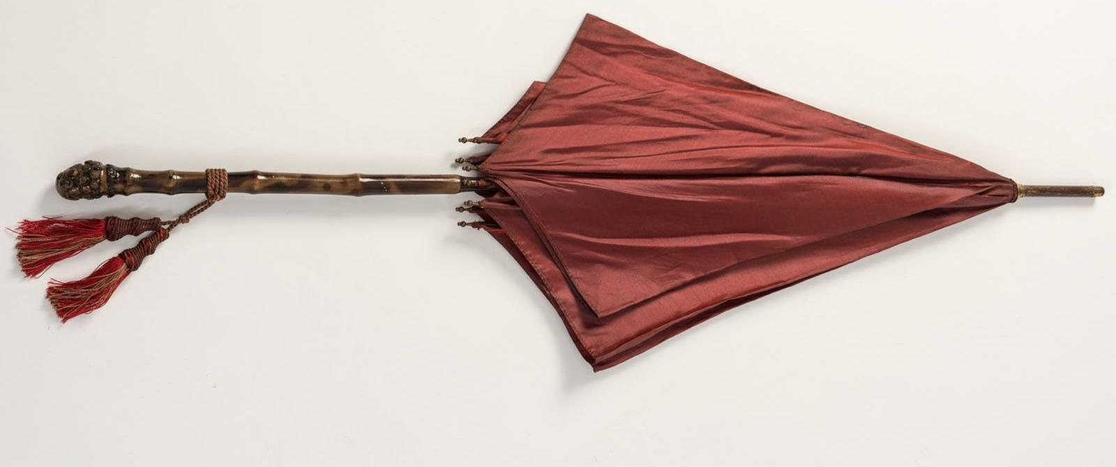 Image: Edwardian red silk parasol