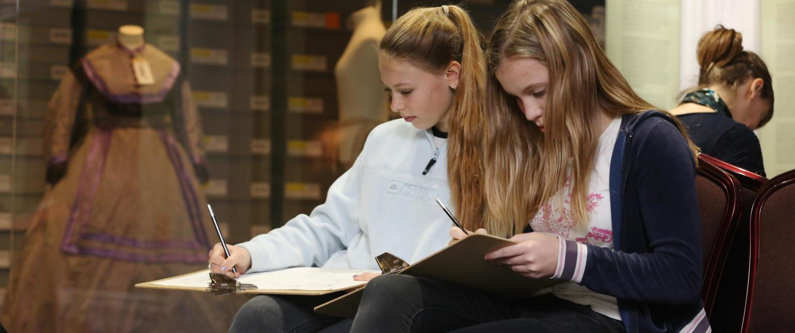Image: Students sketching in the galleries