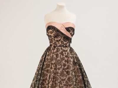 Image: Evening dress, black lace by Norman Hartnell, 1953
