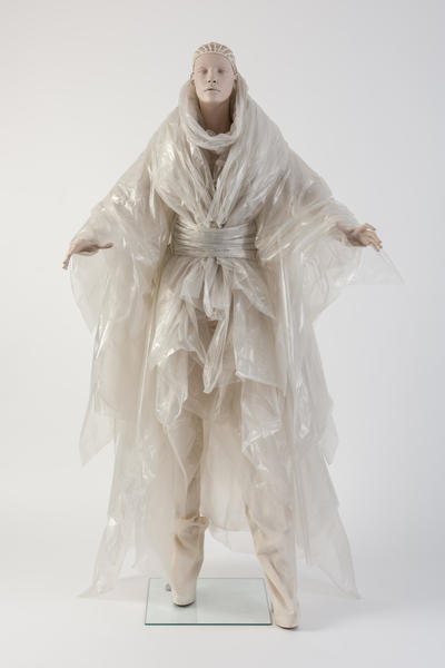 Image: 2014: Gareth Pugh: Plastic coat and wrap ensemble, worn with tied kimono-style belt and calico trousers. Selector: Katie Grand