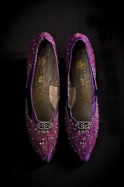 Image: Purple silk satin shoes richly embroidered with glass beads and diamanté, about 1898. Made by Maxen-Gantiez, Paris.