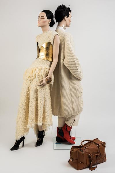 Image: Loewe and JW Anderson: Cream mohair tweed asymmetric fringed dress with gold leaf Napa leather bustier/corset. Cream chunky oversized cardigan, worn with ribbed knit trousers and white shirt with metallic button detail. Selector: Kate Phelan