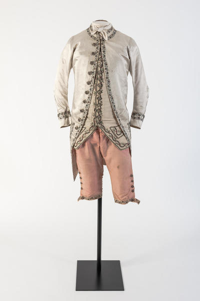 Image: Man's cream silk satin embroidered coat and pink silk breeches, 1780s