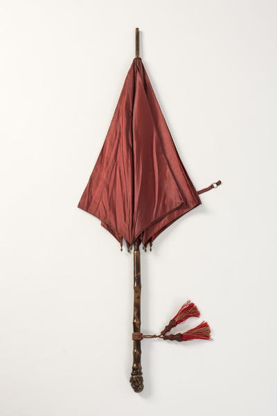 Image: Red silk parasol that belonged to Mary Blathwayt, 1912