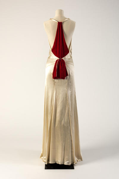 Image: Ivory 'crinkle' weave synthetic evening gown with red velvet feature back. Donguy, Paris. 1930s