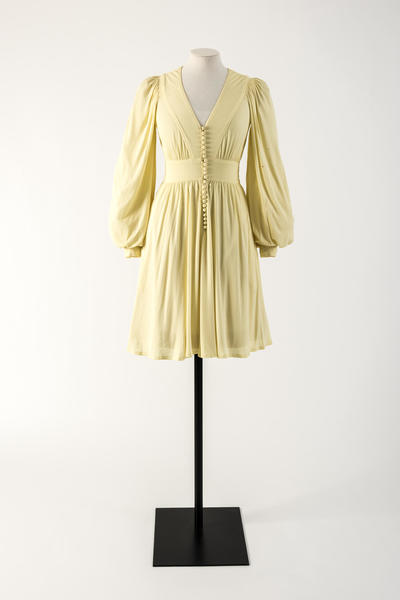 Image: Lemon yellow rayon jersey dress with row of domed buttons. Jean Muir, 1974