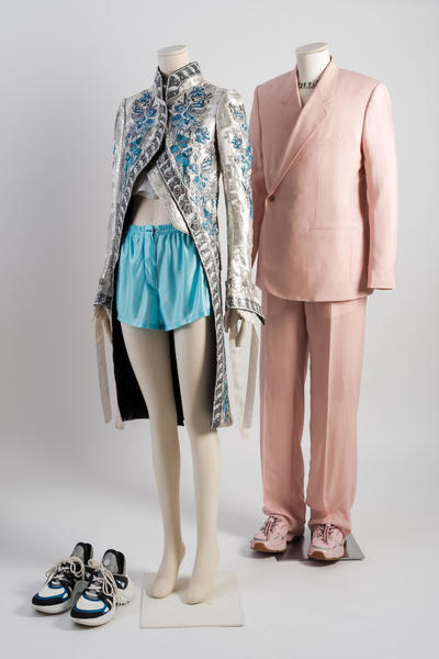 2018: Dior and Louis Vuitton: A light pink cashmere twill double-breasted 'Tailleur Oblique' jacket and high waist wide trousers. Silk embroidered redingote style coat and light blue jersey shorts. Selector: Alexander Fury