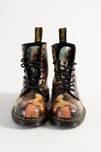 Image: Leather boots printed with 'A Rake's Progress' by William Hogarth, Dr. Martens. Credit: Fashion Museum Bath