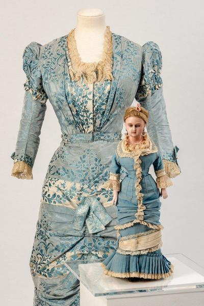 Image: Fashion doll, circa 1880s with pale blue ruched front princess line silk bodice and skirt, 1880s