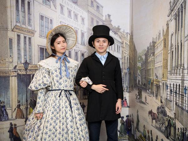 Image: Visitors trying on replica Victorian dress