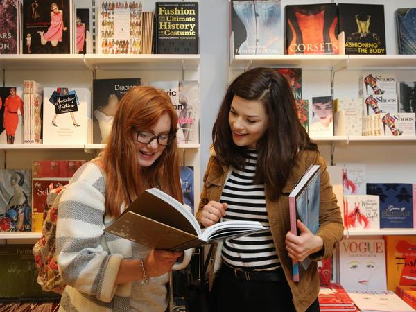 Image: Visitors browsing books in the shop