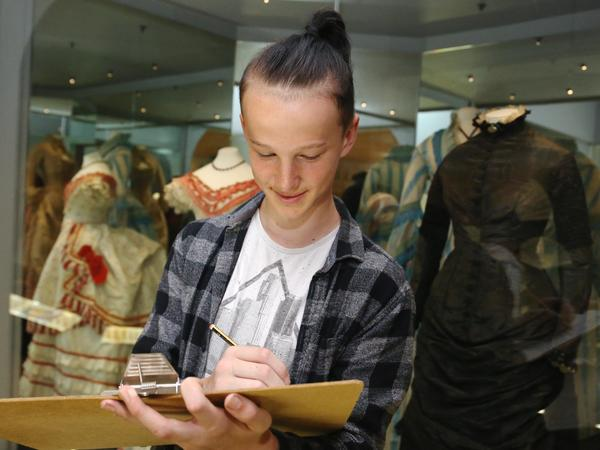 Image: A student sketching in the Museum galleries