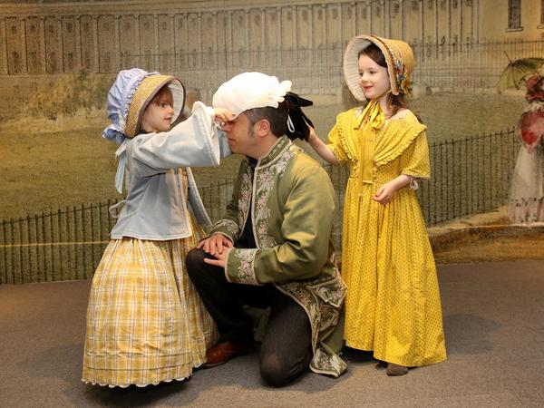 Image: A family dressing up
