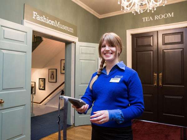 Image: Visitor Service Assistant at the Fashion Museum entrance