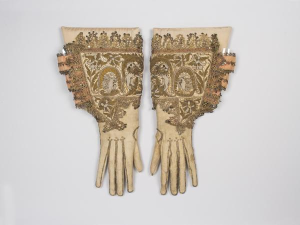 Image: Embroidered gauntlet gloves with pelican and lion design worked in seed pearls and gold metal thread, 1620s