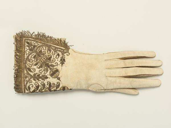 Image: One of a pair of gloves worn by Queen Elizabeth I at her coronation as queen regnant of England and Ireland at Westminster Abbey on 15 January 1559.