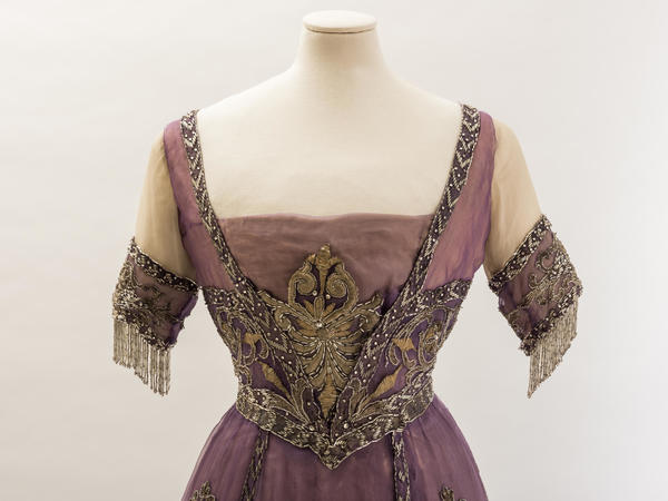 Image: Purple silk chiffon evening dress with embroidered metal thread motifs, bugle beads and diamantés. Worn by Queen Alexandra